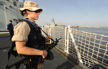 On April 26, 2009 a member of the Naval Boarding Party stands watch as Her Majesty's Canadian Ship (HMCS) Winnipeg participates in an SNMG1 port visit to Karachi Pakistan to increase awareness of NATO activities in the region. Photo: Warrant Officer Carole Morissette, Canadian Forces Combat Camera