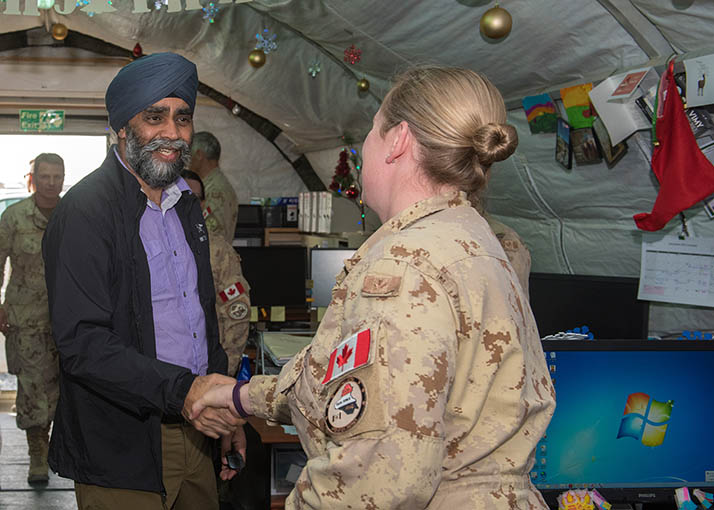 Defence Minister, Harjit S. Sajjan speaks to a deployed member of Joint Task Force-Iraq during a visit to Kuwait on December 19, 2016 during Operation IMPACT. Photo: Op Impact, DND KW06-2016-0047-006