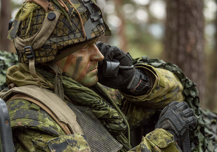 An infantry soldier with 3rd Battalion, Princess Patricia's Canadian Light Infantry uses a field radio to communicate with other members of his team in the Hohenfels Training Area, Germany on Exercise ALLIED SPIRIT VI during Operation REASSURANCE on March 22, 2017. Photo: MCpl Jennifer Kusche, Canadian Forces Combat Camera IS06-2017-0004-114