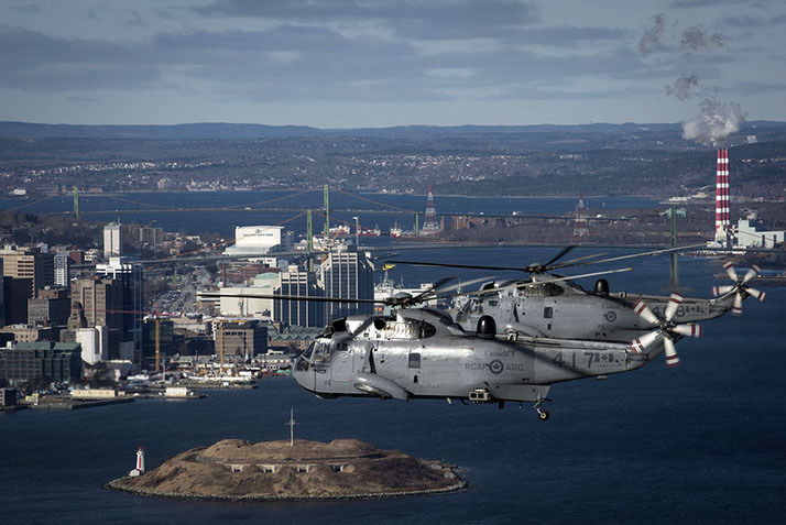 Sea King helicopters from 423 Maritime Helicopter Squadron, based at 12 Wing Shearwater, Nova Scotia, fly over Georges Island in Halifax Harbour on January 26, 2018. It was the squadron's final operational flight with Sea Kings; squadron personnel will now turn their full attention to transitioning to the RCAF's new maritime helicopter, the CH-148 Cyclone. PHOTO: DND, SW05-2018-0015-001