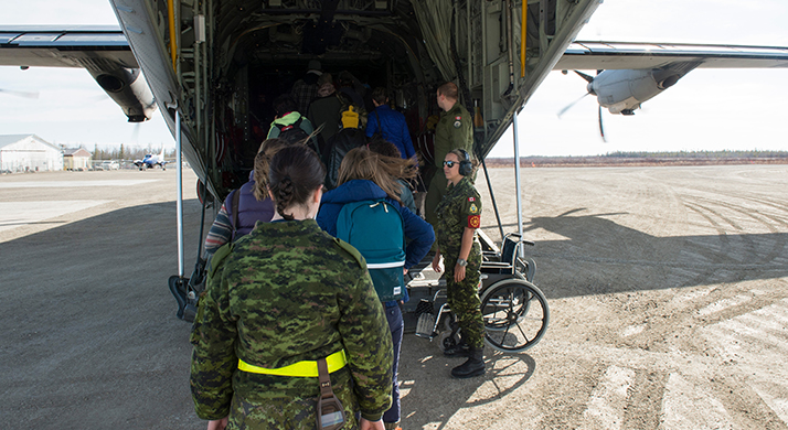 RCAF CC-130J Hercules aircraft from 436 (Transport) Squadron embarks passengers at Kashechewan First Nation, Ontario on May 7, 2018 during a precautionary evacuation in support of a request for assistance from the Province of Ontario. The area was threatened by nearby flooding. Evacuees were taken to safety in Kapuskasing, Ontario. Photo: Cpl Ryan Moulton, 8 Wing Imaging TN11-2018-0144-002.