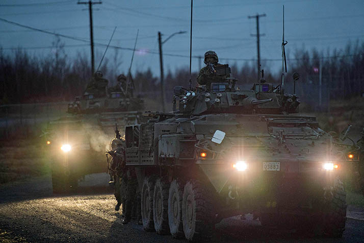 Members of the Canadian Armed Forces make their way towards hostile forces in Austere Village, during the Development Period 3 Bravo Platoon Commander Course held at 5th Canadian Division Support Base Gagetown on May 3rd, 2018. Photo by: OS Zach Barr Canadian Army Trials and Evaluations (CATEU) Gagetown GX2018-0012-002