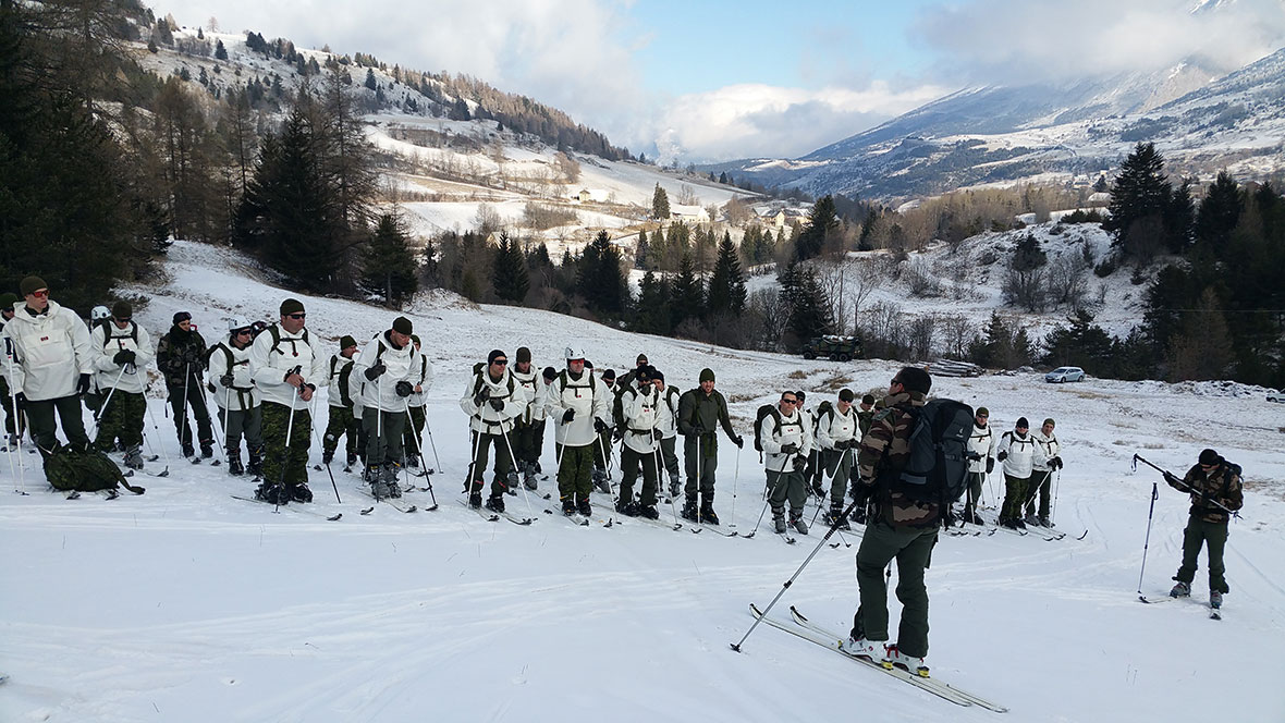 Soldiers listen to climbing instruction given by the mountain detachment chief (French Army) during Exercise CHEVALIER TRICOLORE.  Members of 12e Régiment Blindé du Canada are training with members of the French Army's 4e Régiment de Chasseurs in the Alps.