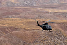 Operation IMPACT. November 8, 2016. A CH-146 Griffon helicopter flies over a hilly terrain for a tactical flying mission in Northern Iraq. (Photo: Op IMPACT, Canadian Forces Combat Camera)
