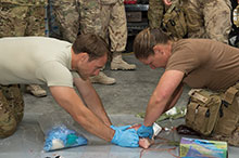 July 7, 2016. Canadian Armed Forces medical technicians and American explosive ordnance disposal technicians practice packing a wound during combat first-aid training near Camp Canada in Kuwait during Operation IMPACT on July 7, 2016. (Photo: Op Impact, DND)