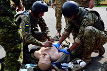 Starychi, Ukraine. A Ukrainian student practices combat first aid on a mannequin during the Advanced Combat First Aid Course in Starychi, Ukraine. For the first time, instructors from the Training Centre are participating in the course along with the best candidates from the 72nd Brigade which is currently undertaking the 55 day training block. (Photo: Capt J.P. Coulombe, PAO JTF-U)