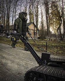 Kamianets-Podilskyi, Ukraine. 9 November 2015 – A Ukrainian Explosive Ordnance Disposal (EOD) specialist walks to go investigate a particular location where a suspicious object was reported during a training session in Kamianets-Podilskyi, Ukraine for Operation UNIFIER. (Photo: Canadian Forces Combat Camera, DND)