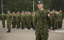 Starychi, Ukraine. 14 September 2015. Major Ben Rogerson, Officer Commanding of the Training Company, stands at attention with his troops during the ceremonies marking the start of Canadian soldiers training Ukrainian troops, during Operation UNIFIER at the International Peacekeeping and Security Centre (IPSC) (Photo: Canadian Forces Combat Camera, DND).