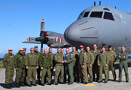 "415 (Long Range Patrol Force Development) Squadron crew from 14 Wing Greenwood, Nova Scotia, display the ""2017 Arctic Maritime Patrol Aircraft Champions trophy""."