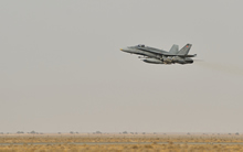 30 October 2014, Kuwait – A Canadian Armed Forces CF-188 fighter jet takes off from Kuwait on the first combat mission over Iraq in support of Operation IMPACT. (Photo IS2014-5022-06 by Canadian Forces Combat Camera)