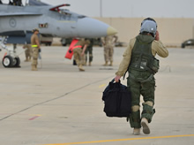 30 October 2014, Kuwait – A Royal Canadian Air Force CF-188 fighter pilot walks down the flight line in Kuwait after his first mission over Iraq in support of Operation IMPACT. (Photo IS2014-5022-12 by Canadian Forces Combat Camera)