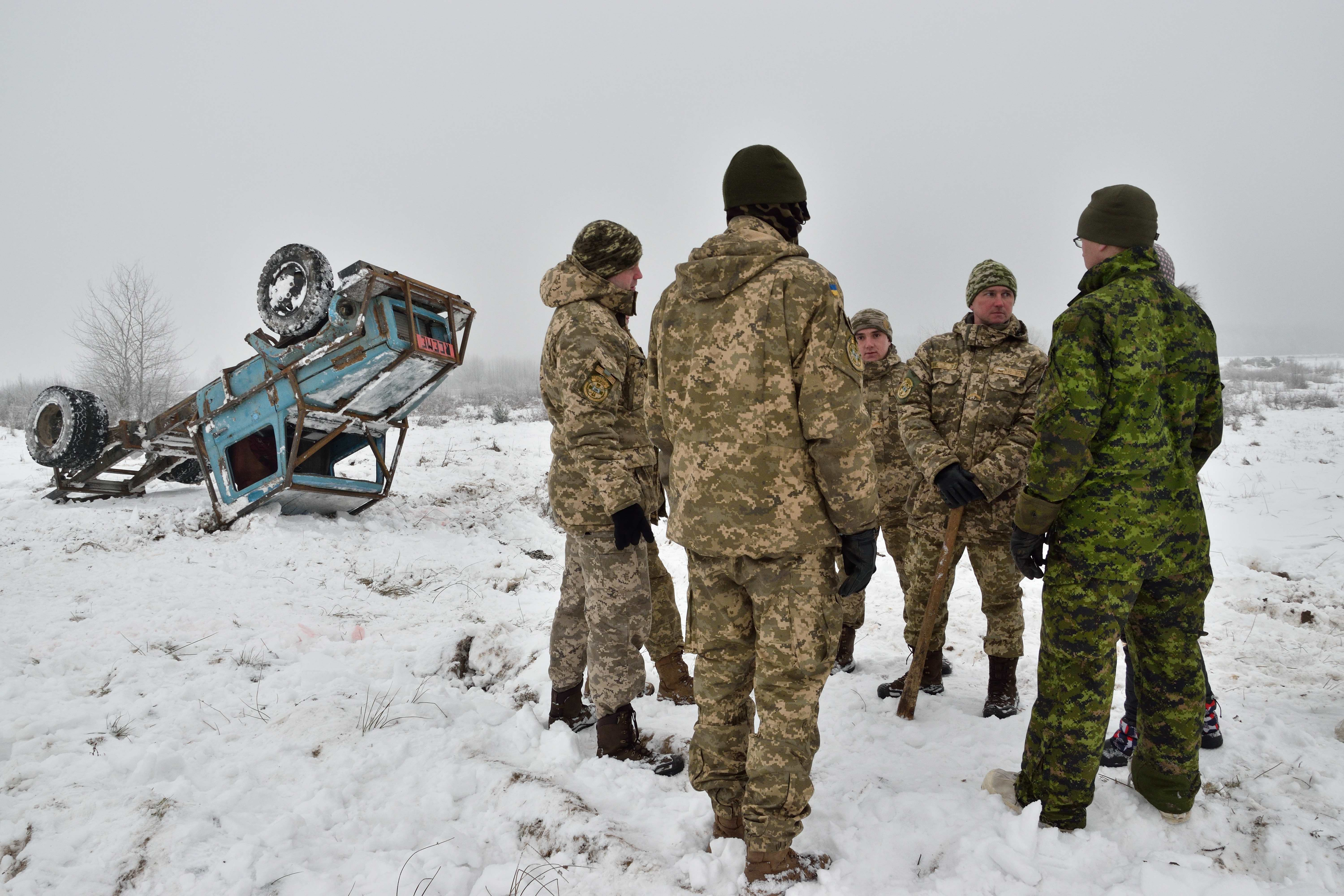A Joint Task Force – Ukraine logistics modernization instructor plans a vehicle recovery with Ukrainian trainees during Operation UNIFIER at the International Peacekeeping and Security Centre in Starychi, Ukraine on January 25, 2017. (Photo: Joint Task Force – Ukraine)