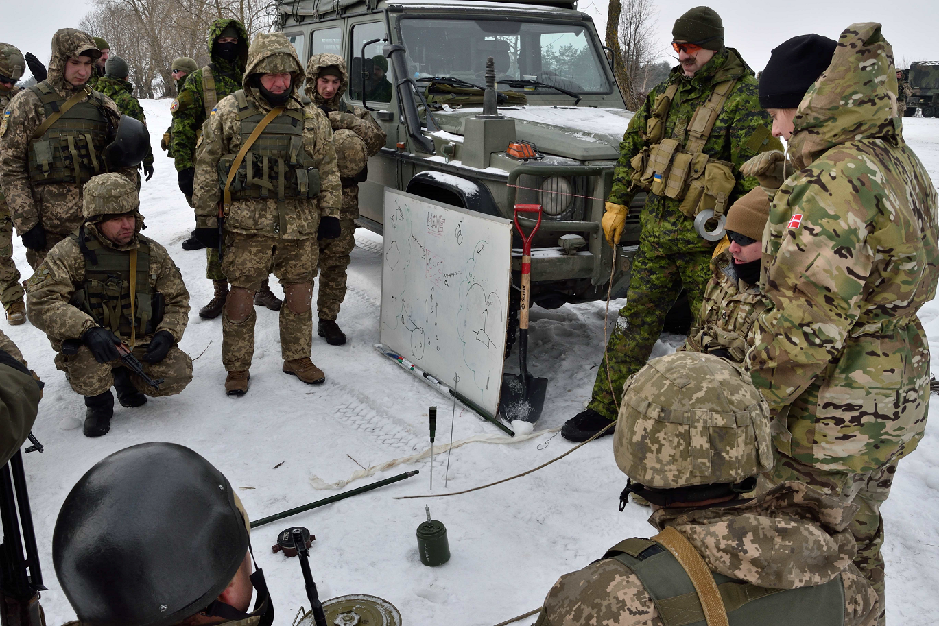 A Danish linguist with Joint Task Force - Ukraine translates for Canadian and American Counter - Improvised Explosive Device instructors teaching Ukrainian soldiers at the International Peacekeeping and Security Centre in Starychi, Ukraine on February 7, 2017. (Photo: Joint Task Force – Ukraine)